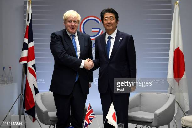 Britain's Prime Minister Boris Johnson meets Japanese Prime Minister Shinzo Abe for their bilateral talks during the G7 Summit on August 26, 2019 in...