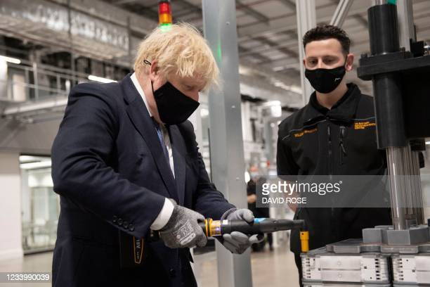 Britain's Prime Minister Boris Johnson meets staff on the production line during a visit to the UK Battery Industrialisation Centre in Coventry,...