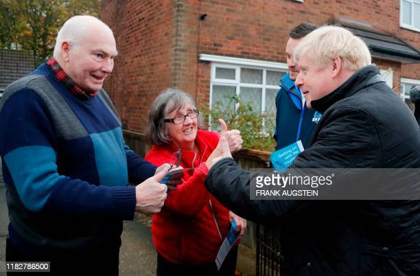 Britain's Prime Minister Boris Johnson meets voters as he canvasses on the General Election campaign trail in Mansfield Nottinghamshire on November...