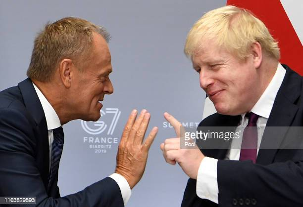 Britain's Prime Minister, Boris Johnson meets with President of the European Council, Donald Tusk at the G7 summit on August 25, 2019 in Biarritz,...