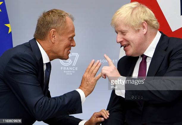 Britain's Prime Minister Boris Johnson meets with President of the European Council Donald Tusk at the G7 summit on August 25 2019 in Biarritz France...