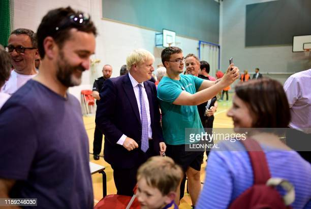 Britain's Prime Minister Boris Johnson meets with rescue crews and local residents at ChapelenLefrith High School as work continued at Toddbrook...
