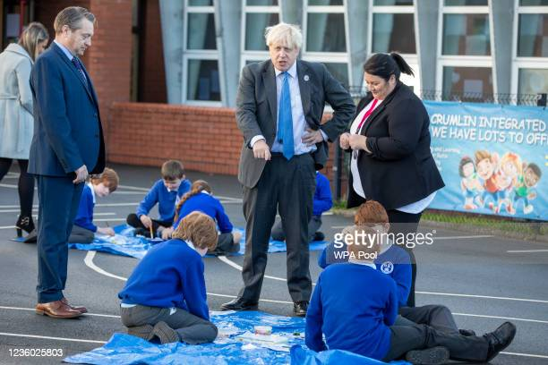 Britain's Prime Minister Boris Johnson meets with staff and pupils during a visit to Crumlin Intergrated primary school after attending a service to...