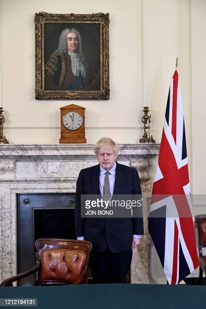 Britain's Prime Minister Boris Johnson observes a 2 minute silence in Downing street to mark the 75th anniversary of VE Day the end of the Second...