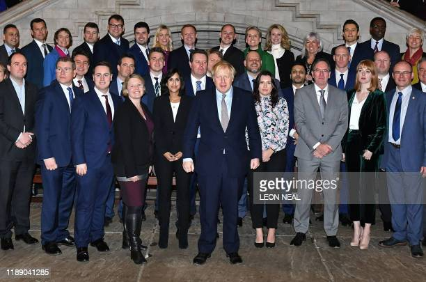 Britain's Prime Minister Boris Johnson poses for a group photo with newly-elected Conservative MPs in the Palace of Westminster, central London on...