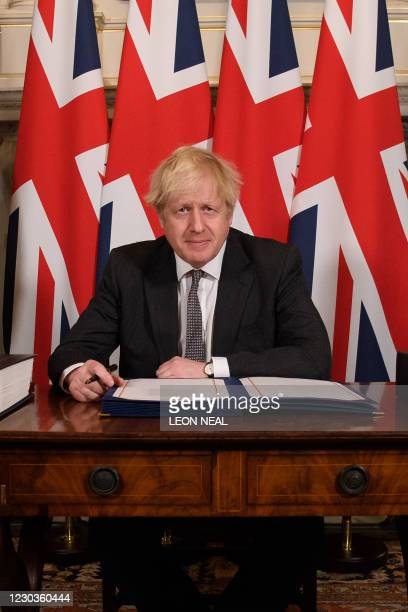 Britain's Prime Minister Boris Johnson poses for photographs after signing the Trade and Cooperation Agreement between the UK and the EU, the Brexit...