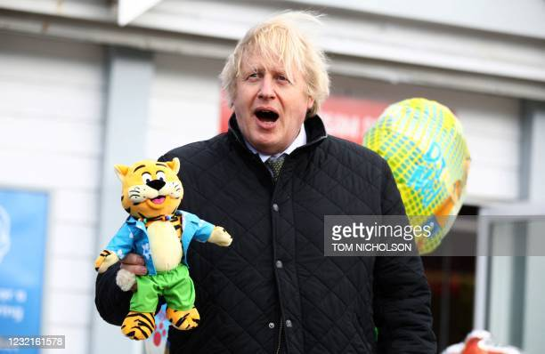 Britain's Prime Minister Boris Johnson poses with a soft toy during his visit to the Haven Perran Sands Holiday Park in Perranporth, Cornwall,...