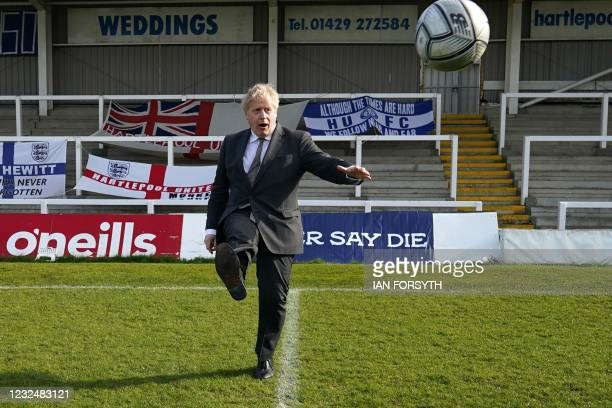 Britain's Prime Minister Boris Johnson practices his skills during a visit to Hartlepool United Football Club as he campaigns on behalf of...