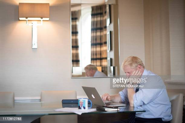 Britain's Prime Minister Boris Johnson prepares his keynote speech for the annual Conservative Party conference in Manchester northwest England on...