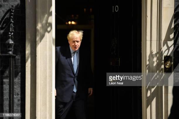 Britain's Prime Minister Boris Johnson prepares to greet his Estonian counterpart Jüri Ratas as he arrives at number 10, ahead of a bilateral meeting...
