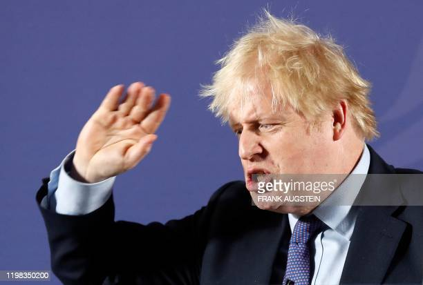 Britain's Prime Minister Boris Johnson reacts as he delivers a speech at the Old Royal Naval College in Greenwich south east London on February 3...