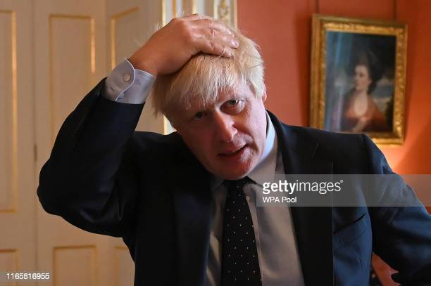 Britain's Prime Minister Boris Johnson reacts as he greets NHS workers as they take afternoon tea inside 10 Downing Street on September 3 2019 in...