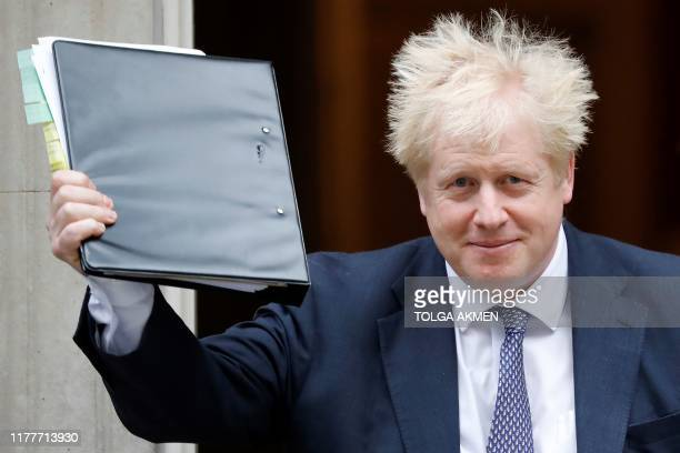 Britain's Prime Minister Boris Johnson reacts as he leaves from 10 Downing Street in central London on October 23 before heading to the House of...