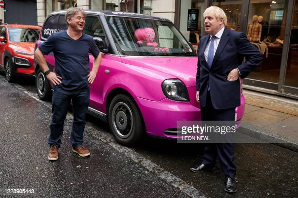Britain's Prime Minister Boris Johnson, reacts as he talks with the Founder and CEO of Octopus Energy Greg Jackson, during his visit to the...