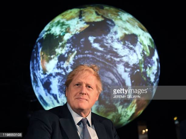 Britain's Prime Minister Boris Johnson reacts during an event to launch the United Nations' Climate Change conference, COP26, in central London on...