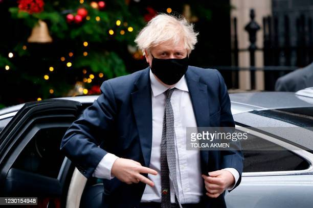 Britain's Prime Minister Boris Johnson returns to 10 Downing Street in central London on December 16 after taking part in the weekly session of Prime...