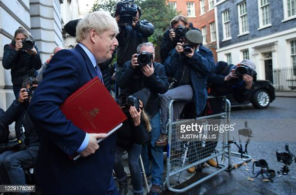 Britain's Prime Minister Boris Johnson returns to 10 Downing Street after attending the weekly cabinet meeting held at the Foreign Commonwealth and...