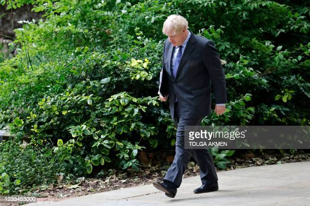 Britain's Prime Minister Boris Johnson returns to 10 Downing Street after giving an update on the coronavirus Covid-19 pandemic inside the Downing...