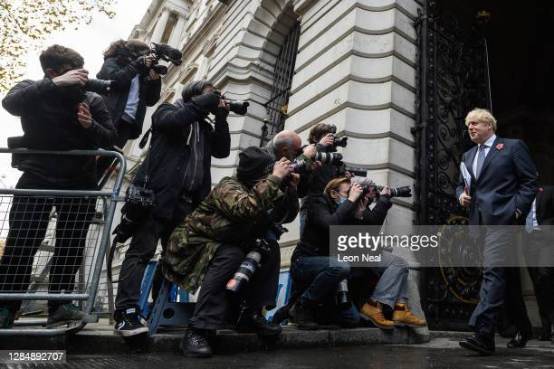 Britain's Prime Minister Boris Johnson returns to number 10 Downing Street following the weekly Cabinet meeting at the Foreign Office on November 10...