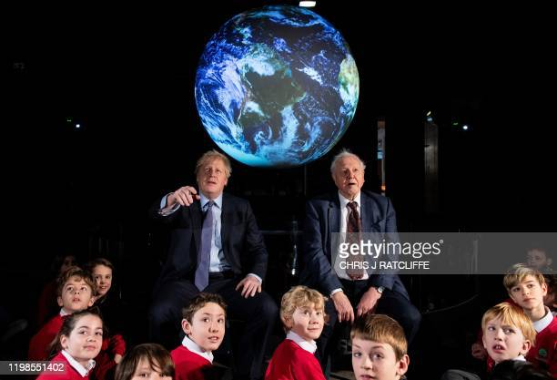 Britain's Prime Minister Boris Johnson sits with British broadcaster and conservationist David Attenborough during an event to launch the United...