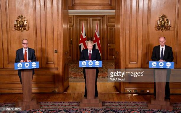 Britain's Prime Minister Boris Johnson speaks during a news conference, flanked by Chris Whitty, the Chief Medical Officer for England and Sir...