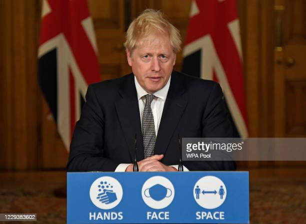 Britain's Prime Minister Boris Johnson speaks during a press conference in 10 Downing Street on October 31, 2020 in London, England. The PM announced...