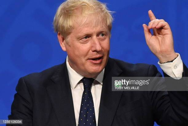 Britain's Prime Minister Boris Johnson speaks during a press conference inside the Downing Street Briefing Room in central London on September 7,...