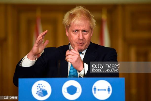 Britain's Prime Minister Boris Johnson speaks during a virtual press conference inside 10 Downing Street in central London on October 16 2020 ahead...