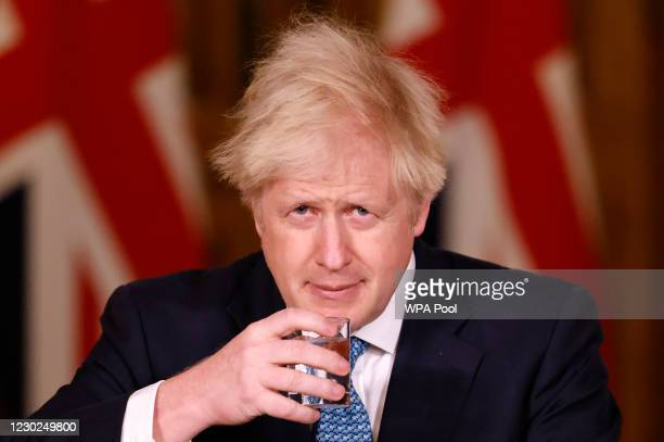 Britain's Prime Minister, Boris Johnson speaks during a virtual press conference inside 10 Downing Street after a string of countries banned...