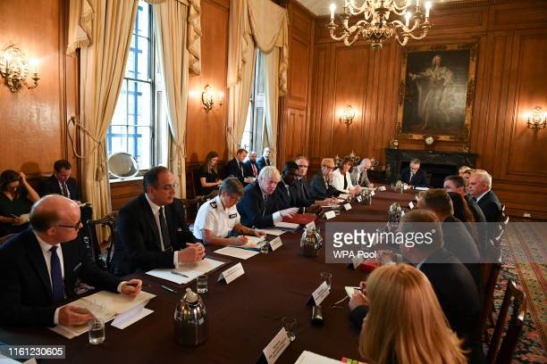Britain's Prime Minister Boris Johnson speaks flanked by Britain's Metropolitan Police Service Commissioner Cressida Dick and Youth Justice Board...
