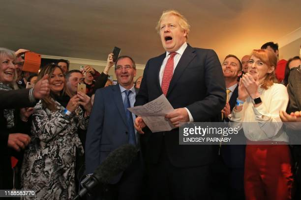 Britain's Prime Minister Boris Johnson speaks to supporters on a visit to meet newly elected Conservative party MP for Sedgefield, Paul Howell at...