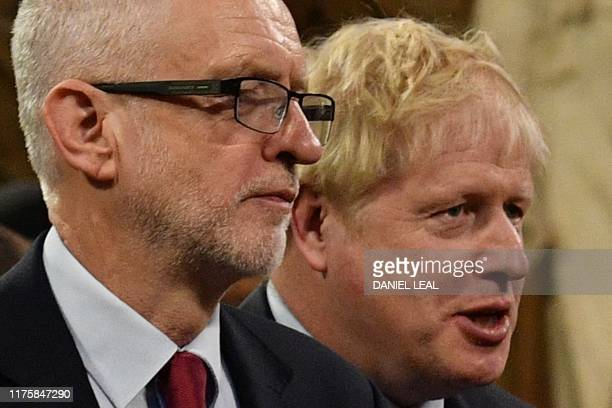 Britain's Prime Minister Boris Johnson speaks with Britain's main opposition Labour Party leader Jeremy Corbyn in the Central Lobby as they walk back...