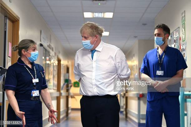Britain's Prime Minister Boris Johnson speaks with Emma Sweeney, Associate Director of Nursing Surgery as he visits Colchester hospital in...