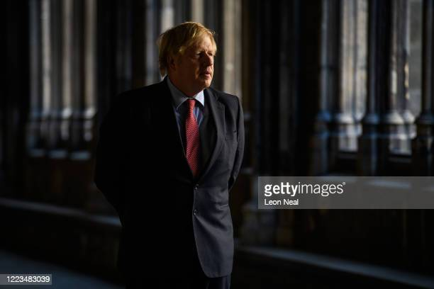 Britain's Prime Minister Boris Johnson speaks with the Dean of Westminster Abbey Dr David Hoyle during a visit to start the VE Day commemorations on...