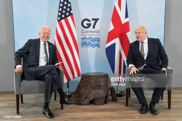 Britain's Prime Minister Boris Johnson speaks with U.S. President Joe Biden during their meeting, ahead of the G7 summit, at Carbis Bay Hotel, on...