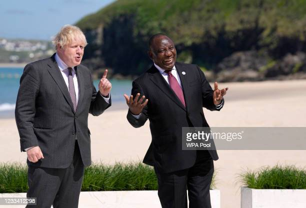 Britain's Prime Minister Boris Johnson stands alongside South Africa's President Cyril Ramaphosa during an official welcome at the G7 summit in...