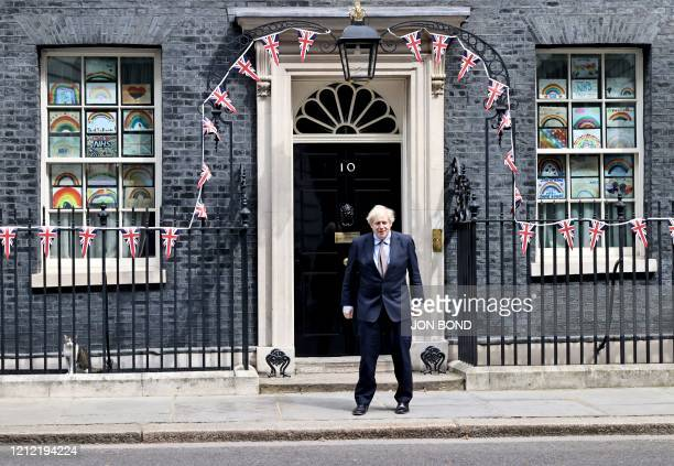 Britain's Prime Minister Boris Johnson stands outside Downing street after observing a 2 minute silence to mark the 75th anniversary of VE Day , the...