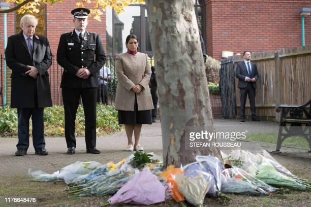 Britain's Prime Minister Boris Johnson stands with with Chief Constable of Essex Police BenJulian Harrington and Britain's Home Secretary Priti Patel...