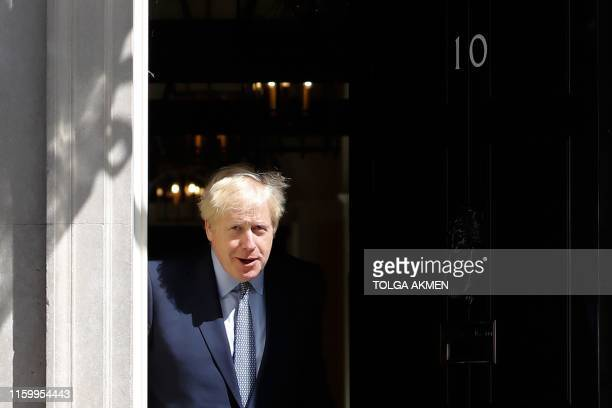 Britain's Prime Minister Boris Johnson steps out of 10 Downing Street in central London on August 6, 2019 to greet Estonian Prime Minister Juri Ratas...