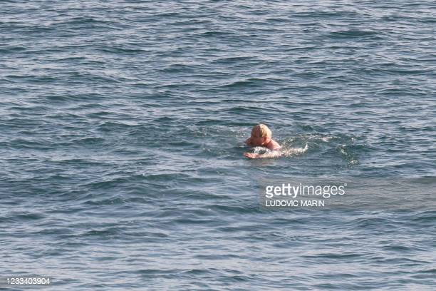 Britain's Prime Minister Boris Johnson swims at Carbis Bay, Cornwall during the G7 summit on June 12, 2021. - G7 leaders from Canada, France,...