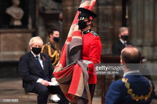 Britain's Prime Minister Boris Johnson takes part in a service to commemorate the centenary of the burial of the Unknown warrior at Westminster Abbey...