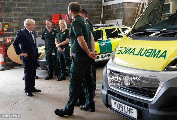 Britain's Prime Minister Boris Johnson talks with ambulance crews during a visit to Pilgrim Hospital in Boston northeast England on August 5 2019...