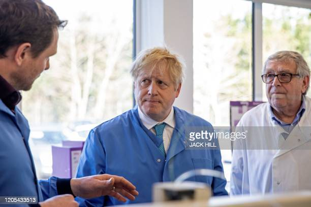 Britain's Prime Minister Boris Johnson visits to the Mologic Laboratory in the Bedford technology Park north of London on March 6 2020 The Prime...