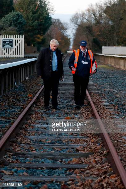 Britain's Prime Minister Boris Johnson walks the rail tracks with Fleetwood Town councillor Brian Crawford during a General Election campaign trail...