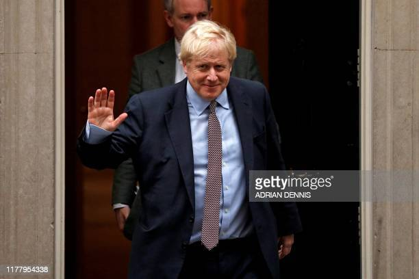Britain's Prime Minister Boris Johnson waves as he leaves 10 Downing Street central London on October 24 after taking a political Cabinet meeting The...