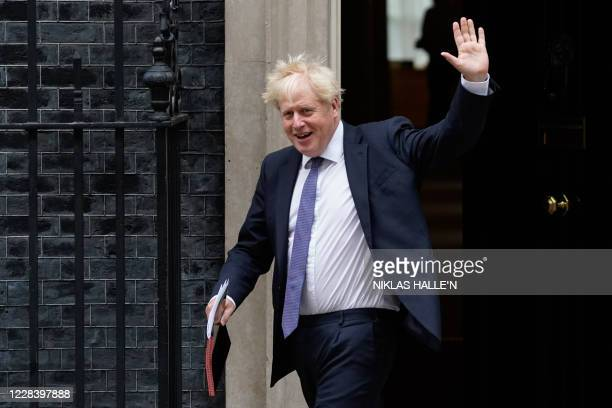 Britain's Prime Minister Boris Johnson waves as he leaves 10 Downing Street in central London on September 8, 2020 to walk across to the Foreign,...