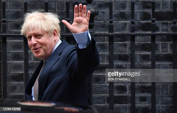 Britain's Prime Minister Boris Johnson waves as he leaves 10 Downing Street in central London on September 9 to attend Prime Minister's Questions at...