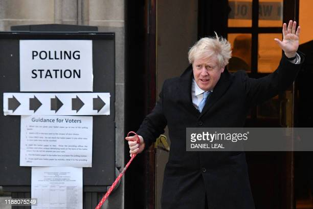 Britain's Prime Minister Boris Johnson waves as he leaves from a Polling Station, after casting his ballot paper and voting, in central London on...
