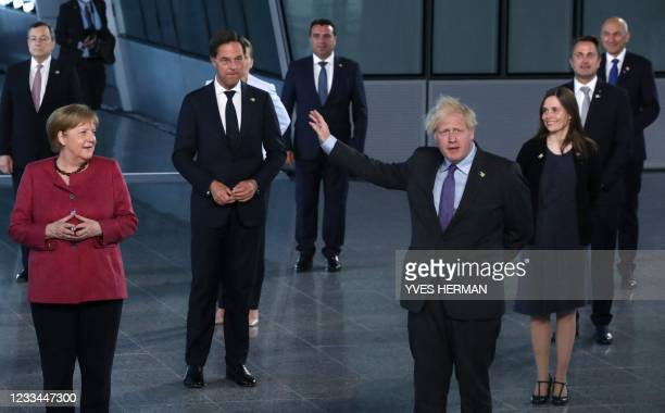 Britain's Prime Minister Boris Johnson waves hands as NATO Heads of the states and governments pose for a family photo prior to a NATO summit at the...
