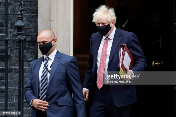Britain's Prime Minister Boris Johnson , wearing a face covering due to the COVID-19 pandemic, leaves 10 Downing Street in central London on October...